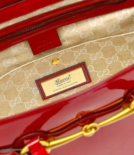 6640e818d0 Gucci s Bright Bit Bag Collection Marks The Chinese New Year ...