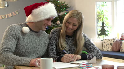 couple-writing-christmas-cards-together